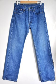 ae496377 Vintage Levi's 501 blue jeans, Made in USA, Medium wash, Medium to High  waist, Button fly jeans, 80s blue jeans, blue denim jeans