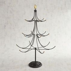Use your imagination to determine the decoration for our handcrafted metal tree. You might opt for a theme tree with rustic woodland touches or a charming country-inspired look with lots of plaid or maybe a very minimalist, modern approach. Star-topped with curved black branches, each ending with a golden ball, our sturdy indoor/outdoor tree comes with its own stand.