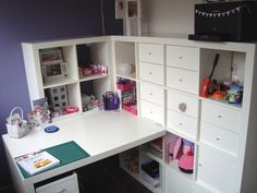 Ikea craft room -- for as many times as I have looked at Expedits, I had never seen nor thought of putting a unit directly behind the desk -- but why not?