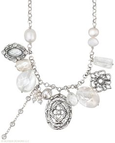 You can just feel the magic of this captivating Necklace. Cubic Zirconia, Pearl, Mother-of-Pearl, Glass, Sterling Silver.