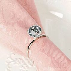 flashy engagement rings used as napkin rings for a bridal shower see more bridal shower