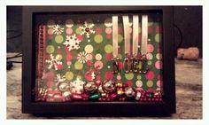 Shadow box! Dollar store shadow box frame, scrapbook paper, ribbon and embellishments...voila.