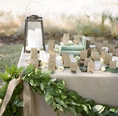 So many beautifully natural elements on this #wedding placeholder table! From http://snippetandink.com/gallery/black-tie-december-wedding-in-charleston/?imgid=29127  Photo Credit http://abryanphoto.com/