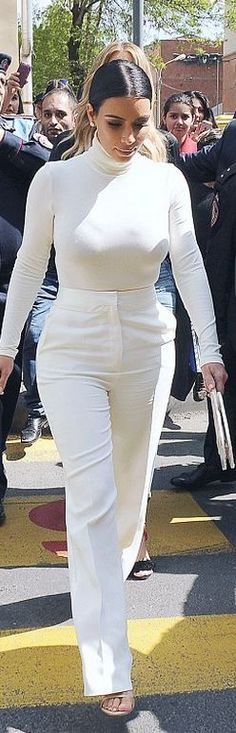 Who made Kim Kardashian's nude sandals, white pants, and long sleeve turtleneck top?