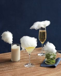 Whimsical cocktails topped with white cotton candy fluff