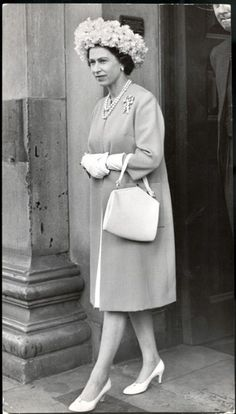 To attend the wedding of the Marque in 1967, Her Majesty plucked the most elegant of accessories, including an unusual white hat made from petals.