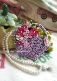 Pretty lavender crochet basket bag decorated with multicolor blossoms and pearl beads. Fill with homemade soaps, teas, jewelry for gifts. Crochet Pouch, Crochet Purses, Crochet Gifts, Knit Crochet, Mini Gift Bags, Crochet Phone Cases, Crochet Mobile, Barbie, Crochet Kitchen