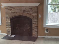 Heat N Glow Cerona Gas Fireplace with the Arch Stone accent Piece installed in Natick MA