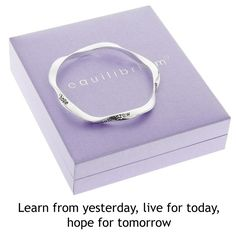 """Equilibrium Silver Plated Bangle - LEARN, LIVE & HOPE.A beautiful silver plated bangle with a special message inscribed on it  """"learn from yesterday, live for today, hope for tomorrow""""  The equilibrium jewellery makes a very special personal gift with a sentimental message ... a gift with meaning  The bangle comes in a beautiful padded gift box, and has a slight twist design so that the inscription can be read from the inside out  Size: 1cm x 8cm"""