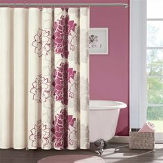 For a splash of color and a fun design, this Lola shower curtain is sure to spark your interest. Made from 100% cotton sateen, this unlined curtain has a slight sheen to its fabric. The fuschia colorway in the flowers is bright, but not overpowering.