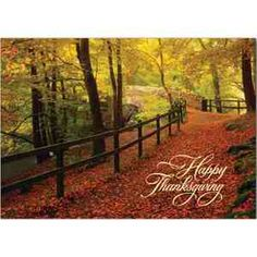 Autumn Trail Thanksgiving Card. Take a walk over the bridge and down this country trail and be amazed at the strikingly vibrant fall foliage, a simple beautiful scene. Gold lined white envelope. Horizontal verses.