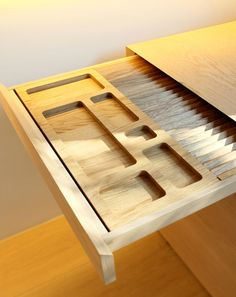The precision of a custom made kitchen drawer by German designers/workshop Holzrausch.