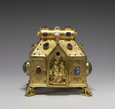 """Reliquary of the Virgin and Saints. This type of reliquary, sometimes called bursa or """"purse-shaped,"""" originated in Germany and Austria in the 13th century. On the back is a long inscription that lists all the relics once contained inside. In the Middle Ages, it was not unusual to combine many relics in one container, thereby increasing the number of saints who could potentially intercede to help answer the prayers of the faithful. Date: late century (Medieval). Walters Art Museum"""