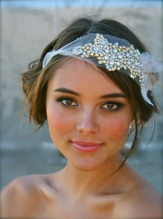 Soooo pretty - love the fresh faced, tanned look! And the headpiece is pretty too! The Classic Crystal and Petal Bandeau- Mini. $400.00, via Etsy.