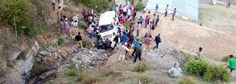 People rescuing injured passengers as Tempo Traveler rolls down the road near Budhal on Friday.