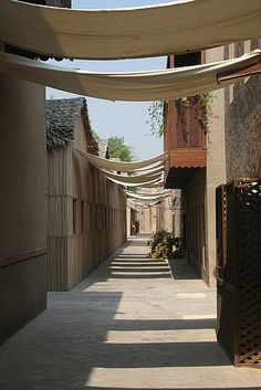 Al Fahidi Historic District, visit one of the oldest historic neighborhoods in Dubai with SMCCU www. Dubai Guide, Desert Resort, Dubai Holidays, Desert Life, Natural Building, Sharjah, Slums, A Whole New World, Futuristic Architecture