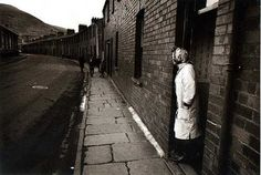 .C.Rapoport, Everyday since the tragedy this mother waits at her door for her son to come home from school, Aberfan, Wales, 1966. (On the 21st of October 1966, 144 people, 116 of them children, were killed when a man-made mountain of coal waste slid onto the village of Aberfan in South Wales).