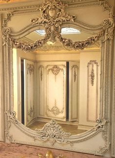 European style #InteriorArchitectural detailing is one of my favorite things to do.  I love this Classical #Mirror in an amazing #LuxuryCloset. Stunning! Can you imagine twirling ii an evening gown?