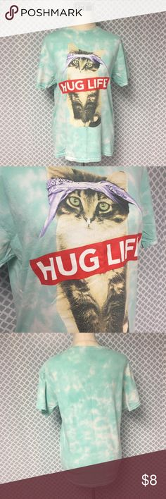 Kitten Hug Life T Shirt Description: Adorable kitten Hug Life T Shirt Unisex size medium			  Condition: Good – Some peeling, but still in great shape  Material: 100% cotton		  Measurements:       Pit to Pit – 20 inches       Shoulder to Hem – 26.5 inches                Inventory:    ⭐️ 15% Off All Bundles!     Thanks for stopping by!  Tops Tees - Short Sleeve
