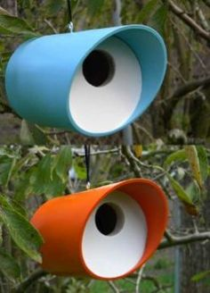 Entice feathered friends to nest at your place with a mod tube birdhouse! Handcrafted of durable vinyl with sturdy wooden entry and back, the tube is the perfect size for songbirds to nest in total co
