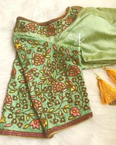 Beautiful green color designer blouse with floral design hand embroidery thread work on yoke. Kids Blouse Designs, Hand Work Blouse Design, Stylish Blouse Design, Hand Designs, Flower Designs, Wedding Saree Blouse Designs, Pattu Saree Blouse Designs, Blouse Designs Silk, Blouse Patterns