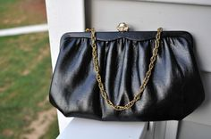 Vintage Black Clutch, with Gold Painted Rose Clasp and Chain by NotJustOldVintage on Etsy https://www.etsy.com/listing/207049843/vintage-black-clutch-with-gold-painted