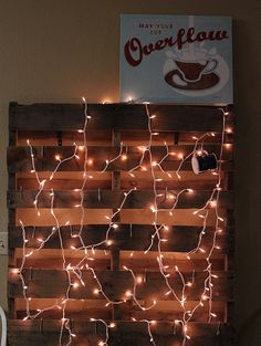 twinkle lights. finally a pallet idea i love.  this could work in so may ways.
