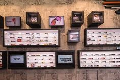 Oakley display.  Possible to show product in light boxes and have branded boxes contain backstock.