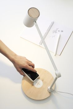 The ikea RIGGAD work lamp not only features long-lasting LED bulbs, but a built-in charging pad for your smartphone. Usb, Work Lamp, Smartphone, Paint Shades, Home Technology, Co Working, Luz Led, Led Lampe, Incandescent Bulbs