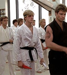 Johnny Lawrence clutching those flags a little tight, aren't you? Maybe the fist clenching trick was yours all along. Karate Kid Original, The Karate Kid 1984, Karate Kid Movie, Karate Kid Cobra Kai, William Zabka, Cobra Kai Dojo, 1980s Films, Great Movies, Iconic Movies