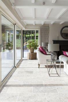 An elegant living room featuring Tumbled Travertine stone flooring. by stoneandwoodshop Stone Tile Flooring, Travertine Pavers, Modern Flooring, Flooring Ideas, Flagstone, Stone Tiles, Living Room Flooring, Kitchen Flooring, Floor Design