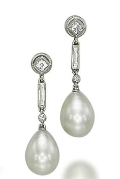 A PAIR OF ART DECO NATURAL PEARL AND DIAMOND EARRINGS, BY CARTIER   The two drop-shaped natural pearls, measuring approximately 8.9-9.0 x 11.7 mm and 8.7-8.8 x 11.6 mm, each suspended from a baguette-cut diamond collet with a square-cut diamond top, 1920s, 3.0 cm, with French assay marks for platinum  Signed Cartier #Perles #pearls #pérolas