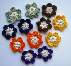 Crochet Flowers Mini - Fall Colors - Set of 12 (Cream Centers with Brown, Orange, Green, Yellow, Purple & Navy Pedals). $3.80, via Etsy.