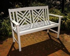 This elegant fretwork bench makes a lovely addition to any patio or garden! It is made of eco-friendly harvested Eucalyptus grandis and features a UV-resistant white polyurethane finish. The bench mea