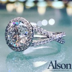 2.50 carat round brilliant diamond engagement ring in a criss-cross diamond pave setting. www.alsonjewelers.com or call us at 216-464-6767 for more information.