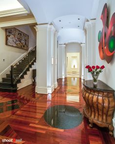 stop and smell the roses. entry with stairs and long hallway, hardwood floors