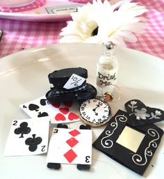 Today at my arts and craft group we are doing floating cups and as it will be going in my kitchen I thought I would keep with the Alice in Wonderland theme so I made some miniature playing cards, a top hat, pocket watch , mirror and I used an old aftershave sample bottle with drink me on it.  #upcycle #recycle #revamp #aliceinwonderland #miniture