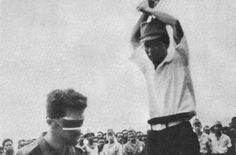 Leonard Siffleet about to be beheaded with a sword by a Japanese soldier, 1943