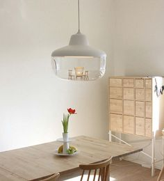 Chen Karlsson Pendant Light: With this lamp you can let your treasured objects be exhibited and highlited beneath a light source.