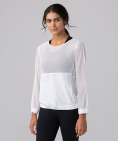 Feel the summer breeze on your  skin during outdoor boot camp  classes or on your commute  home from the beach in this  pullover made from two types  of breathable Mesh fabric.