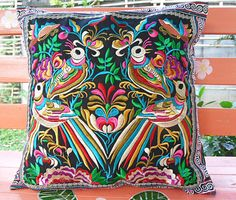 This beautiful cushion cover is made from a piece of Hmong embroidered textile fabric, with a beautiful tropical bird design  Back is plain black