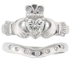 Love this Claddagh engagement ring and matching wedding band!  (Though, I already wear a Claddagh on my right hand every day!)   Love. Loyalty. Friendship.