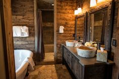 Log cabin rustic bathroom! What a beauty.