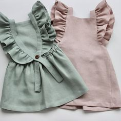 Pure linen girls dress from 0-3months up to 5-6years. Made from a sea green colour which is custom to us, we have named it aqua! The detail to the shoulder frills is pristine and it comes complete with adjustable button fastening. Sizing is true to size if not a little roomy Machine