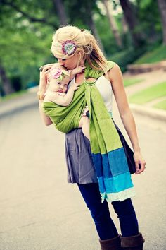 DIY sling - two rings, long strip of fabric...this is great b/c you can pick the cute fabric! :)