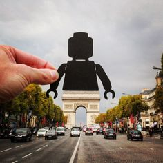 British photographer Paperboyo uses papercuts and forced perspective to make humorous and whimsical comments on the world's landmarks.