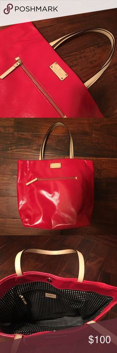 Kate Spade Red Canvas Tote Kate Spade Red Canvas Tote. Used once, excellent condition, no signs of use. It has one outer zipper pocket and one inside. The lining is black with white polka dots. I could see this being a great purse for work. Leather handles and patent canvas body. Has four feet on the bottom. Dimensions TBA. kate spade Bags Totes