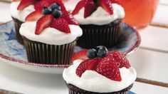 Fresh fruit and a dreamy, creamy frosting top these moist cupcakes.