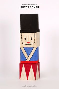 Handmade Nutcracker Stacking Blocks, a friendly little chap to stack on his head and knock down again, and again. Perfect for babies age 12mt+   MollyMooCrafts.com