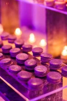 Tasty macarons in a matching hue were just one of many desserts gracing this 16ft dessert bar. Design by Alchemy Fine Events, Desserts by Sweet & Saucy Shop